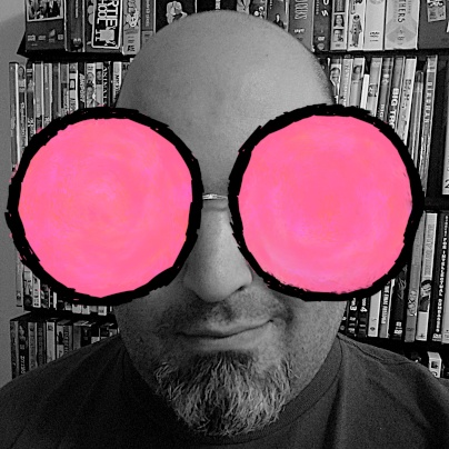 Cast photo of Rob, with the Modern.Technology bug logo's big pink circle eyes pasted over his own.